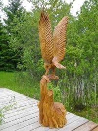 Landing Eagle With Fish On Tree Stump